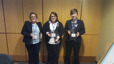 three BPA students holding awards