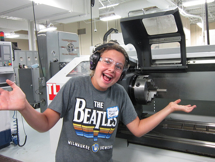 student smiling near equipment