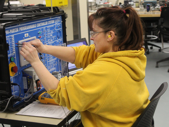 female student using programmable controller system