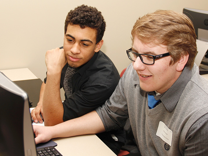 two students working at computer