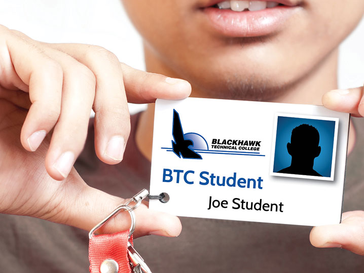 Student holding ID