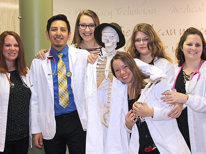 Health Science Students Smiling with Skeleton