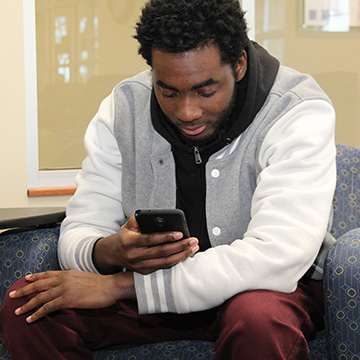 male student using smartphone