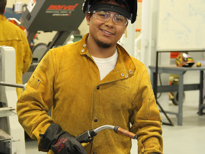 Welding Student with Torch